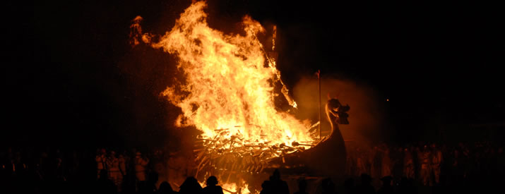 A replica Viking Galley ablaze during Up Helly Aa