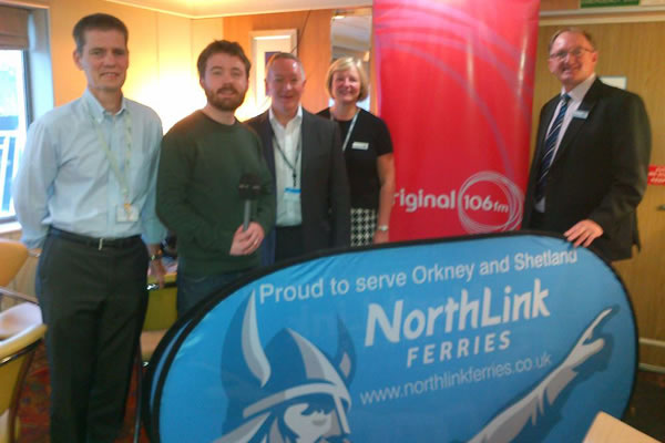 Fiona Anderson (Service Manager), Stuart Garrett (Managing Director), Peter Hutchinson (Senior Manager Vessel Support Services) and Steve Moreton (IT Manager NLF) with DJ David Lewis.