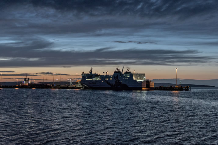 The Aberdeen to Shetland ship stopping at Hatston, near Kirkwall on the Orkney Islands in the late evening.