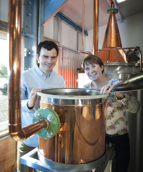 Martin and Claire with their still at Dunnet Bay Distillery in Caithness
