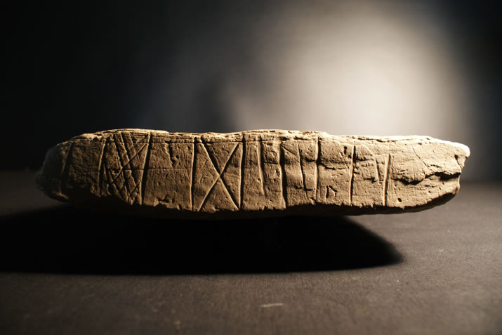 Decorated slab from St 8 at the Ness of Brodgar, Orkney
