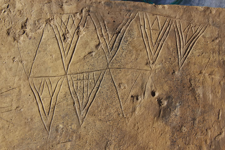 Decorated stone from St 10 at the Ness of Brodgar, Orkney