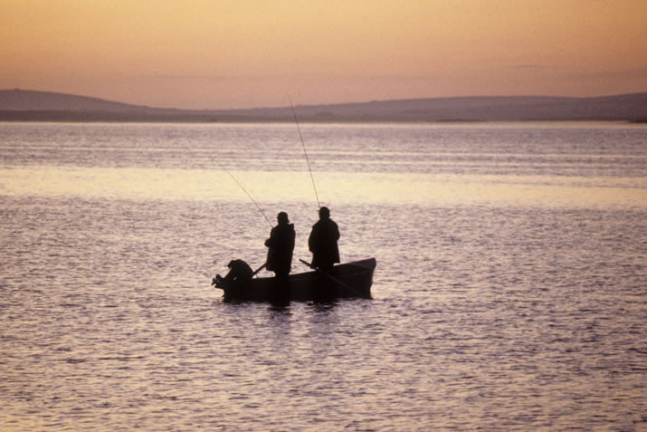 Fishing from a boat on the Loch of Harray, Orkney