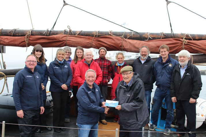 NorthLink present the Swan trust with a cheque