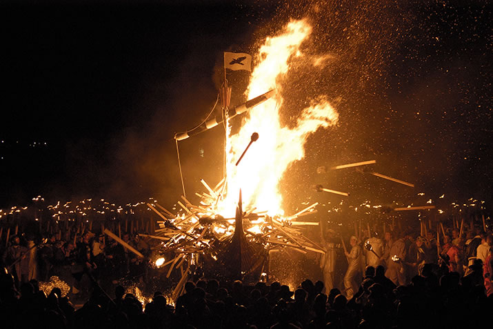 Throwing flaming torches into the galley during Up Helly Aa, Shetland