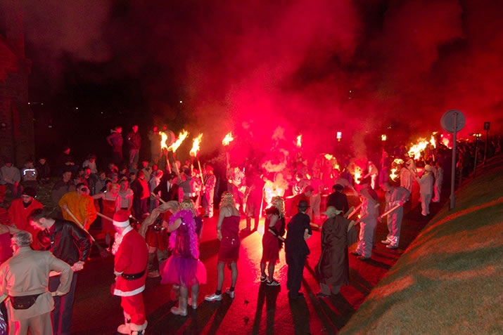 Guizers lighting up during Up Helly Aa