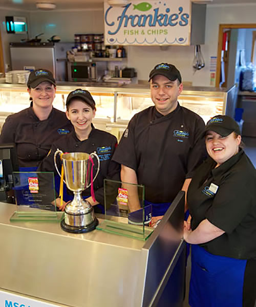 Frankie's Fish and Chip Shop staff with awards