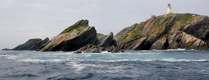 Muckle Flugga Lighthouse from the sea by Ian Cowe