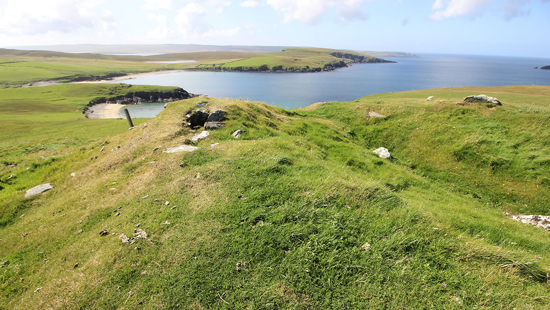 Broch and sandy bay where longships arrived in Unst, Shetland