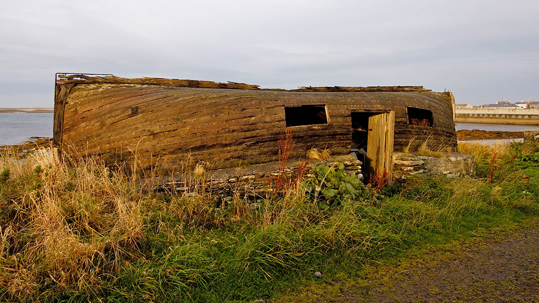Shed with upturned lifeboat from SS Athenia, Whitehall, Stronsay, Orkney