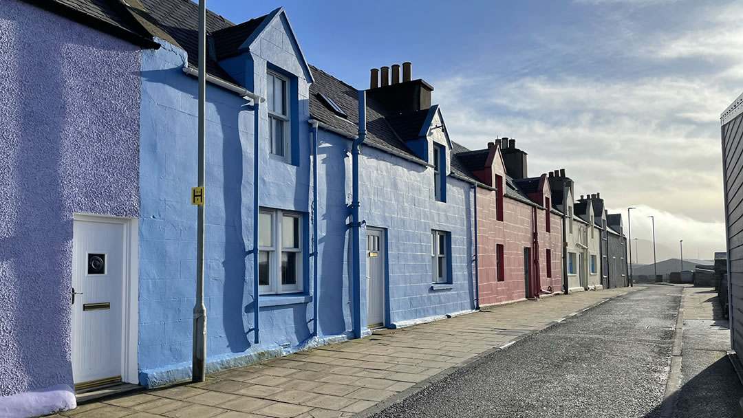 Colourful and vibrant houses on the New Street road, Scalloway, Shetland