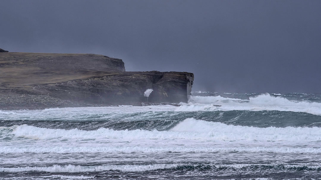 Winter waves exploding through the Hole o'row, Skaill, Orkney