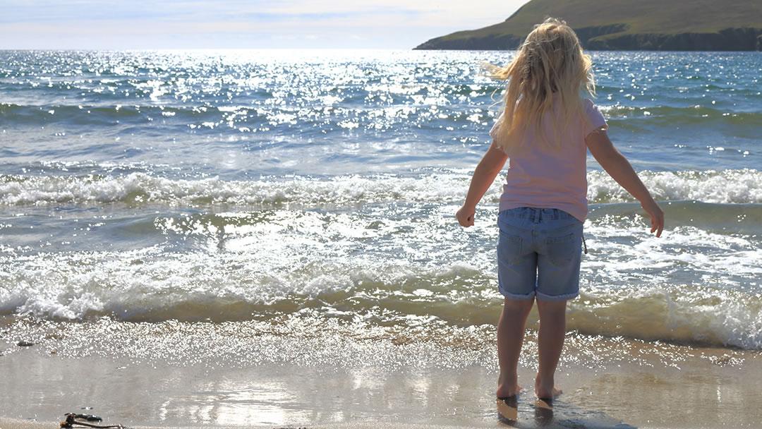 Paddling at Tresta beach in Fetlar, Shetland